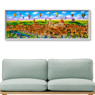 quadro con dipinta una panoramica di firenze e un divano